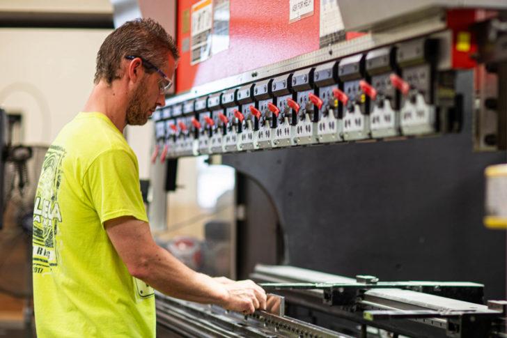 Dawson employee setting up a brake
