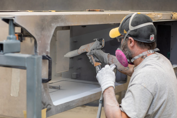 An employee performing powder coating in Dawson finishing facility