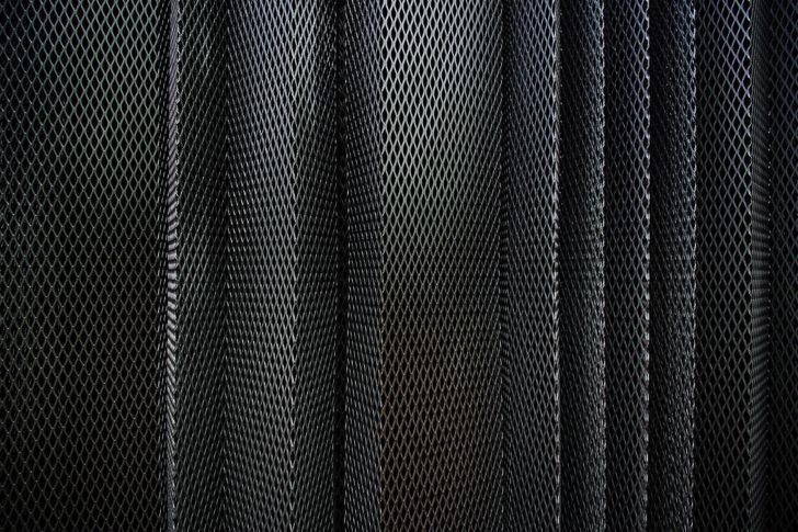 A metal criss-cross grid in undulating pattern