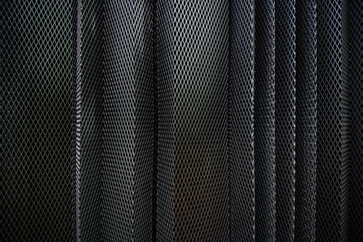 A metal criss-cross grid in undulating pattern